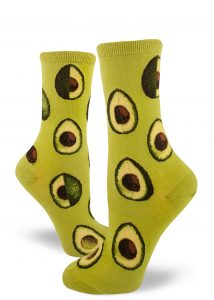 Avocados in various stages of being sliced make up the pattern on these green crew socks for women.