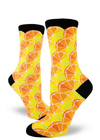 A pattern made from citrus wheels on black women's crew socks.
