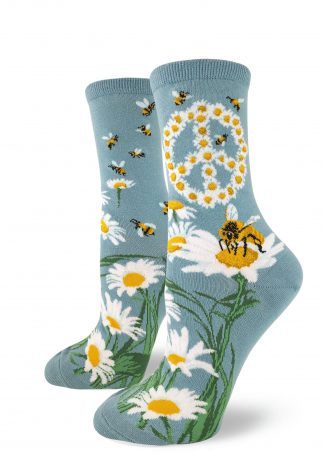 A peace sign made out of daisies with bees buzzing around on these blue crew socks for women.