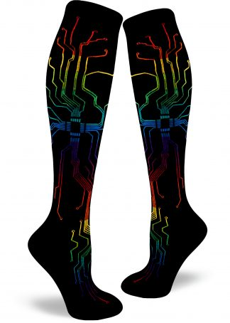 Rainbow circuitry branches across a black background on these sleekly geeky women's knee socks.