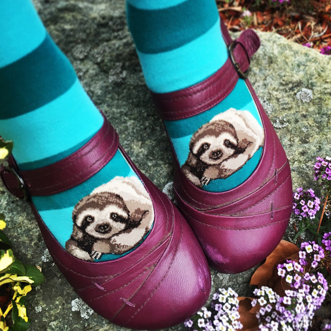 Sloth socks for women by ModSocks feature cute sloths with stripes.