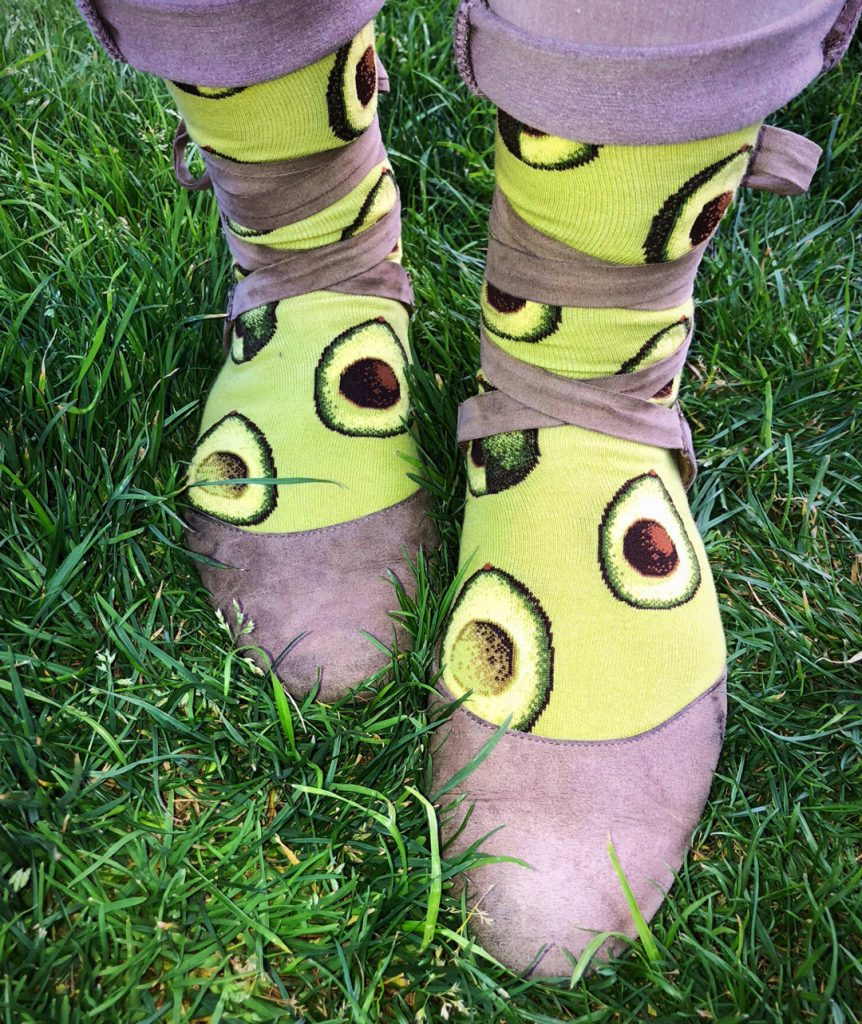 Avocado socks by ModSocks with ripe avocados freshly cut like moon phases.