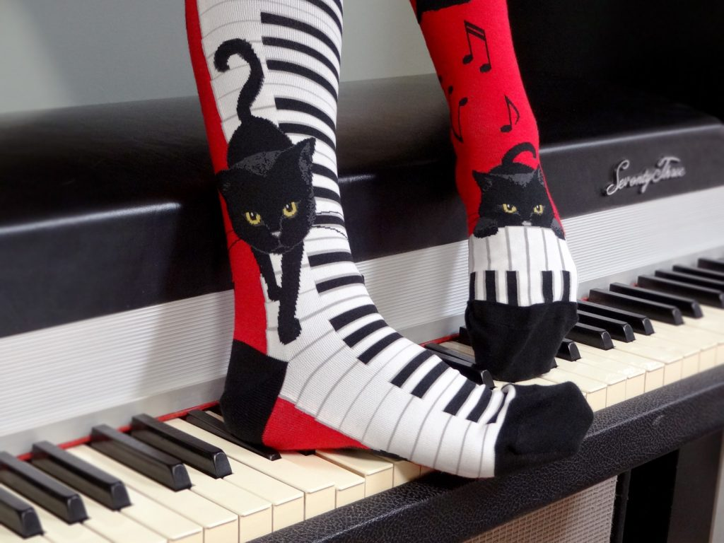 Piano cat socks by ModSocks in red knee high socks for pianists and cat lovers.