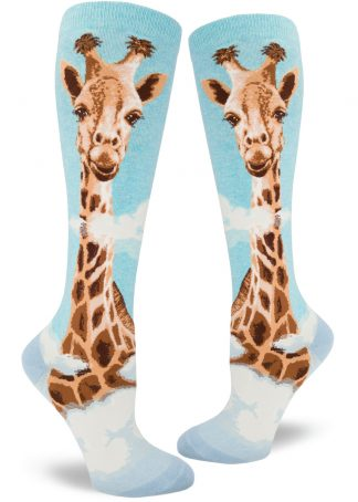 A giraffe with his head in the clouds on knee-high aqua socks.