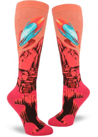 Red and orange knee socks show a blue retro rocket leaving the planet Mars.