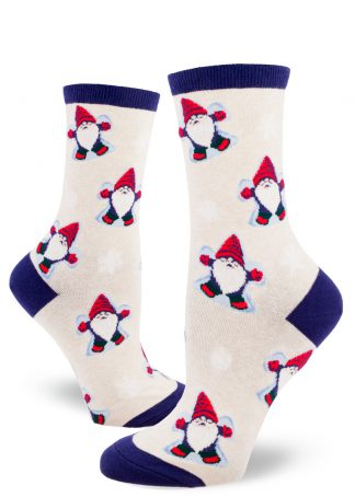 Gnomes dressed in red caps, mittens and boots make snow angels on these festive women's crew socks with a heather cream background.
